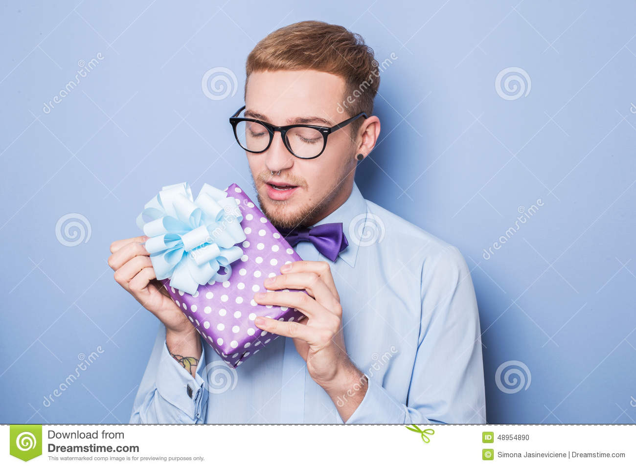 Gifts For Young Men: Closeup Portrait Of Happy Excited Young Man With Colorful