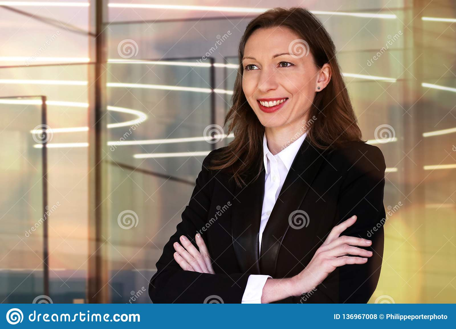 Woman in Finance business welcoming guests to a meeting