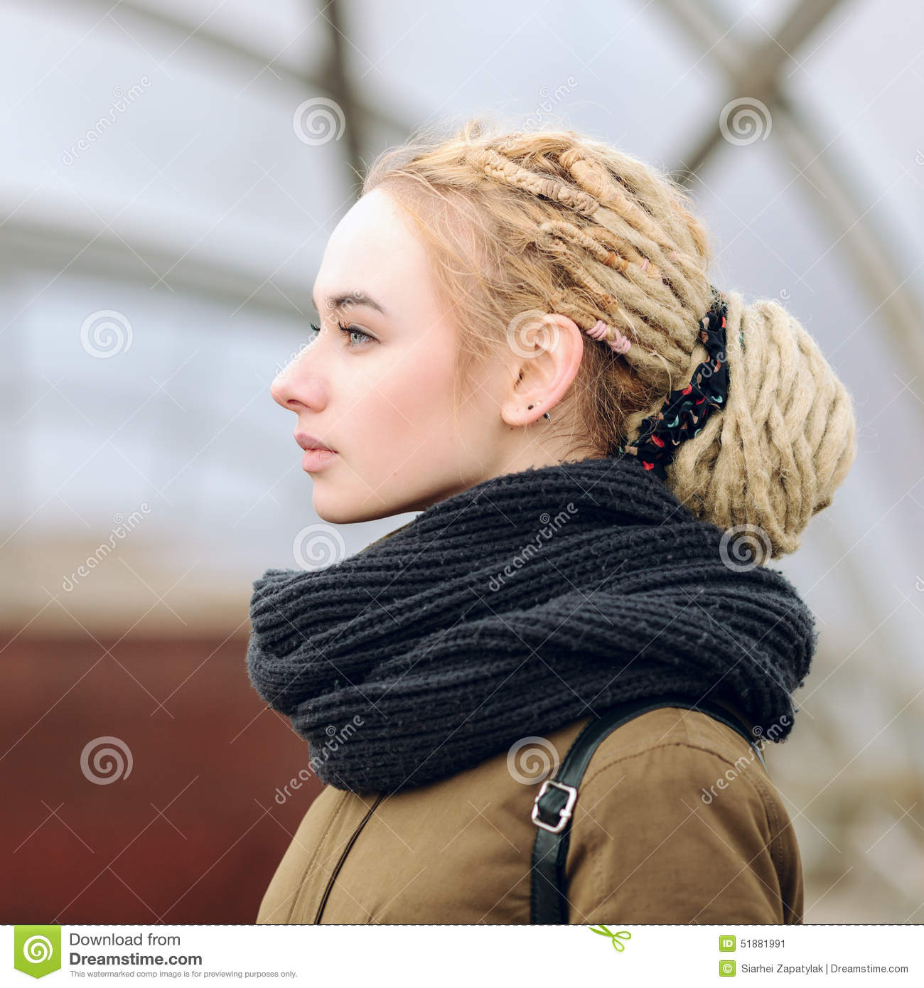 Closeup Portrait Of Young Beautiful Blonde Woman With A Dreadlocks