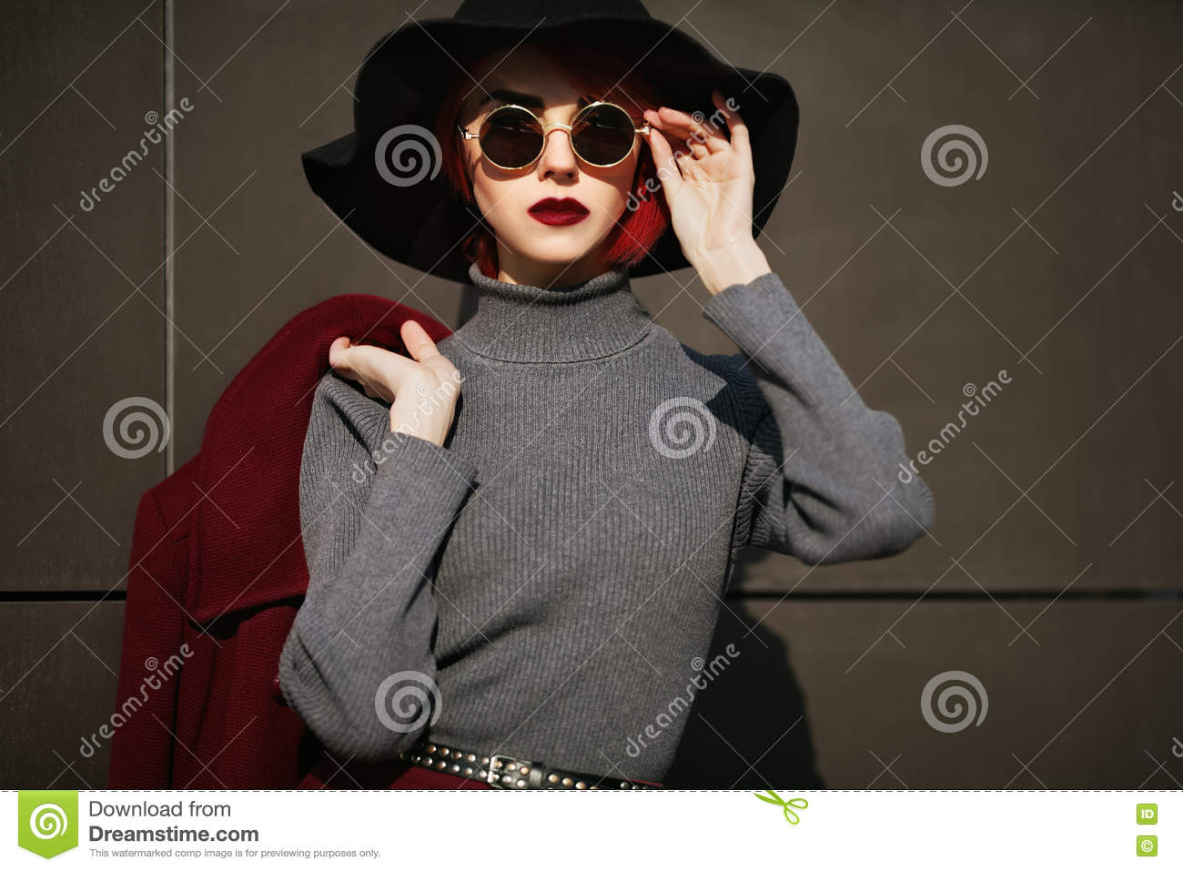 4a2c34758b5 Closeup portrait of young beautiful fashionable woman with sunglasses. Lady  posing on dark grey background. Model wearing stylish wide-brimmed hat. Girl  ...