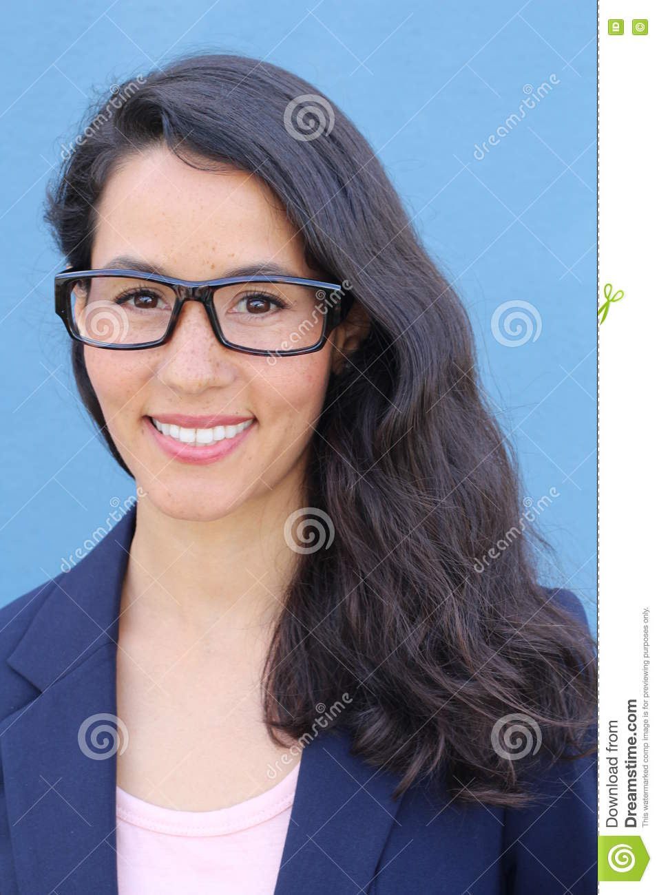 Closeup portrait, young professional, beautiful confident adult woman in blue blasier, with black glasses, smiling isolated indoor