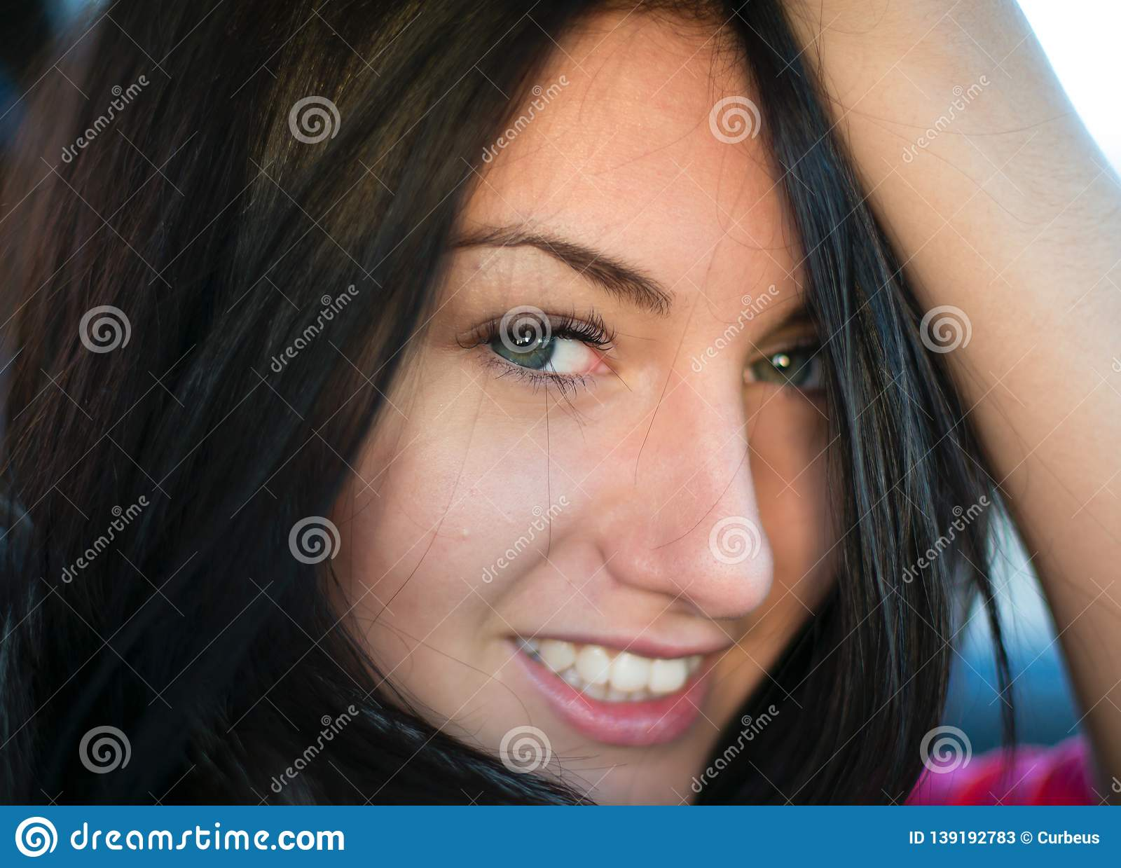 CloseUp portrait of Young Woman Smiling at Camera