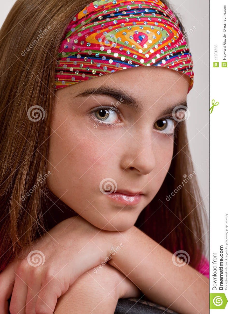 Closeup of young pre-teen girl with retro headband.