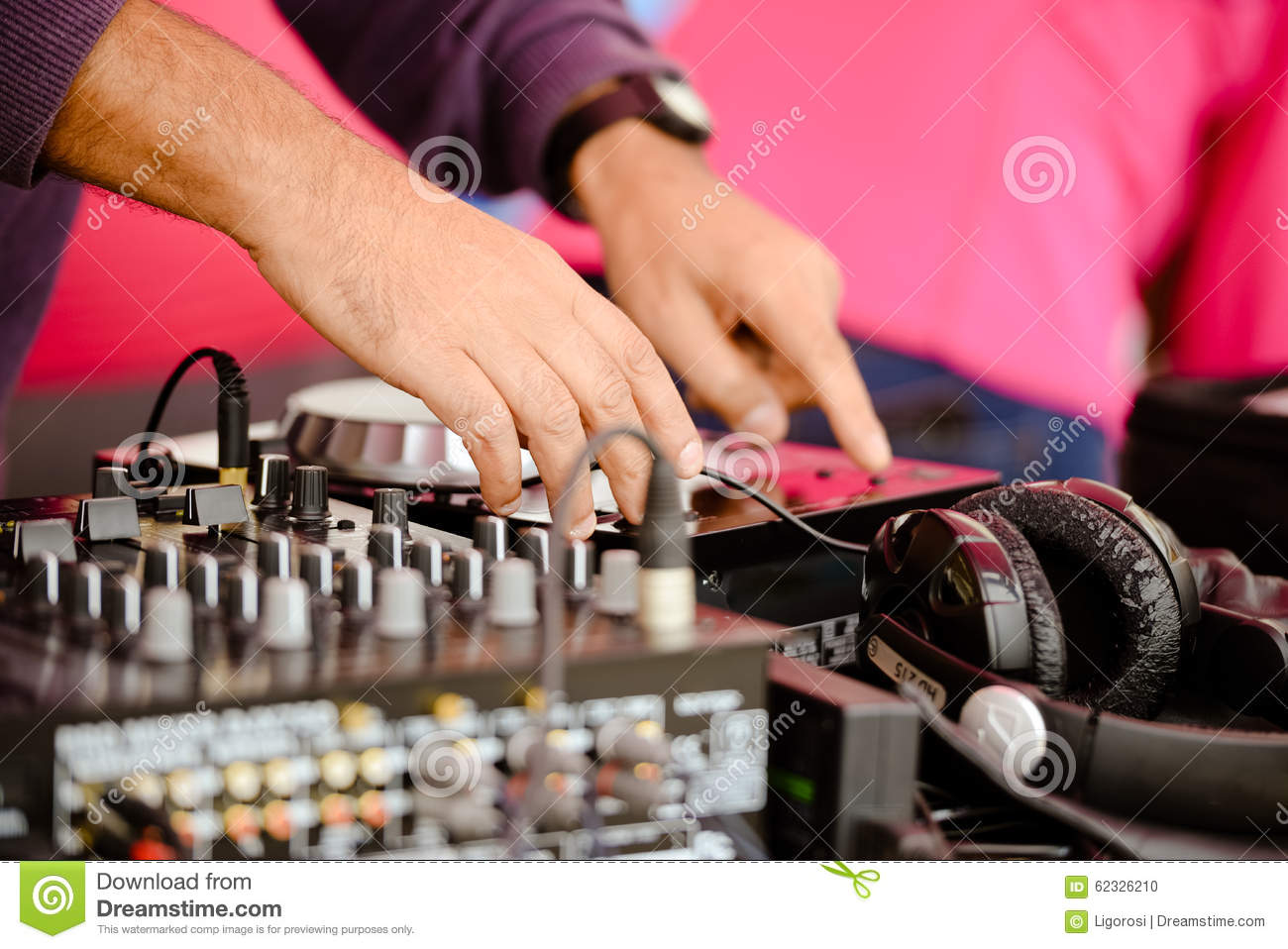 Closeup of producer s hands working with musical