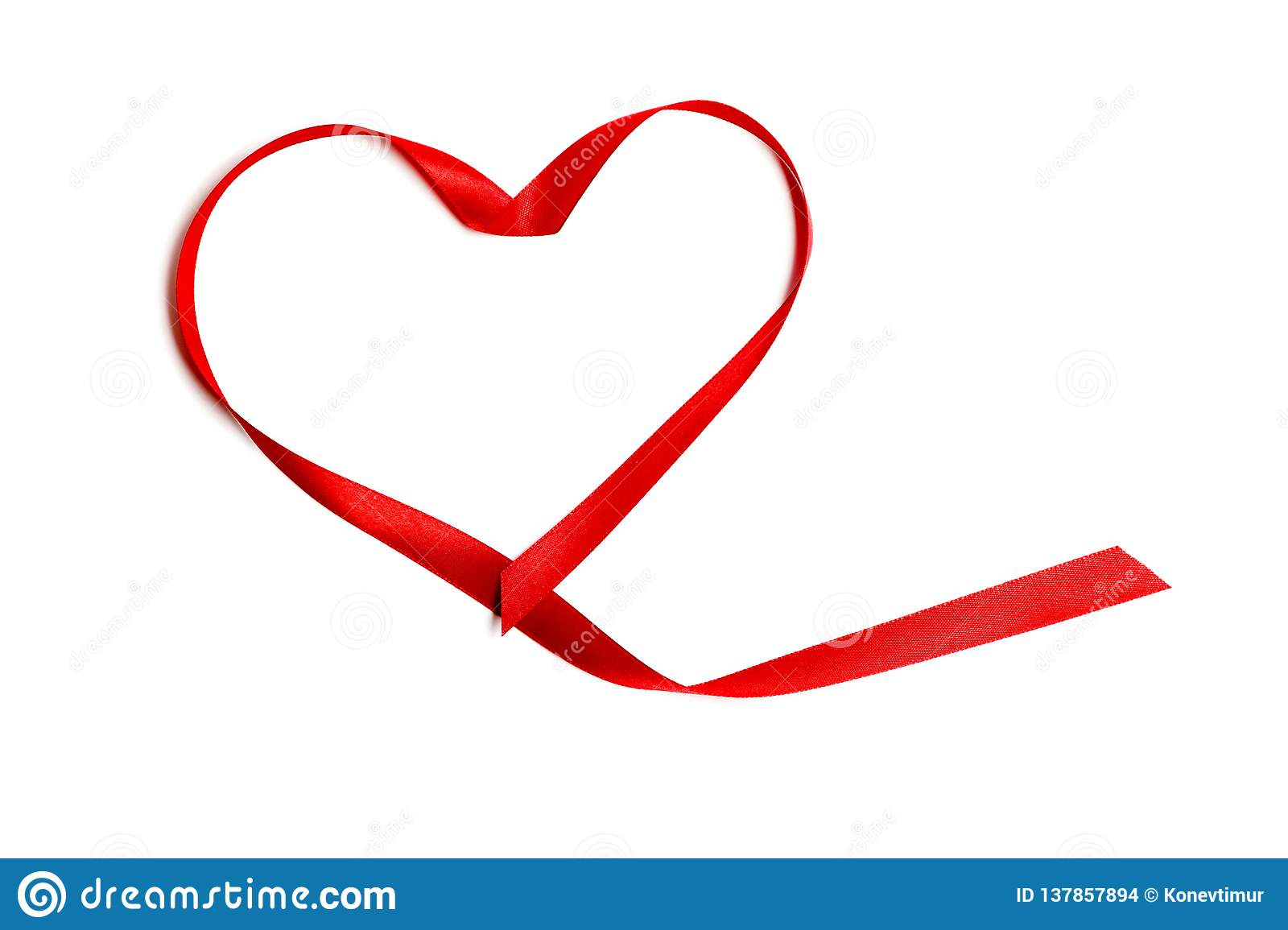 Closeup red satin ribbon or tape in heart shape, isolated on white background. Concept Valentine`s Day, wedding anniversary,
