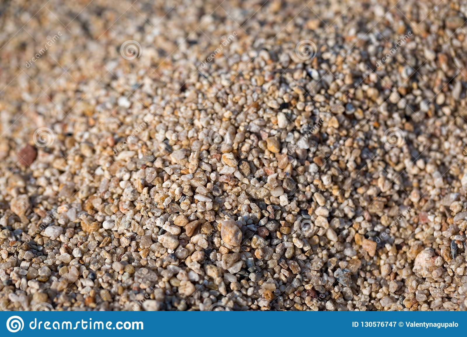 Closeup of sand on the beach. Crystals of sea sand as background. Macro