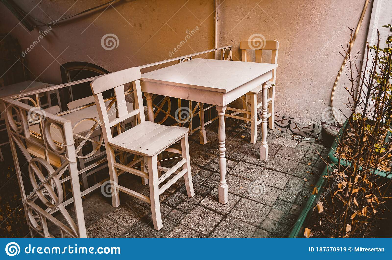 Small White Color Painted Wooden Table And Two Wooden Chairs On The Nice Garden Stock Image Image Of Table White 187570919