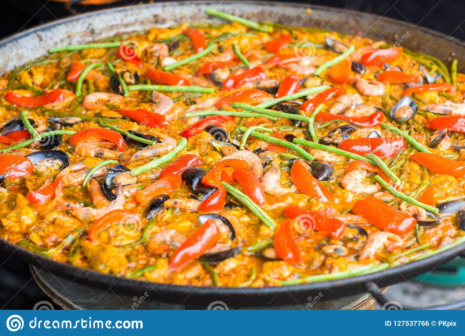 Closeup of Seafood Paella in a large frying pan.