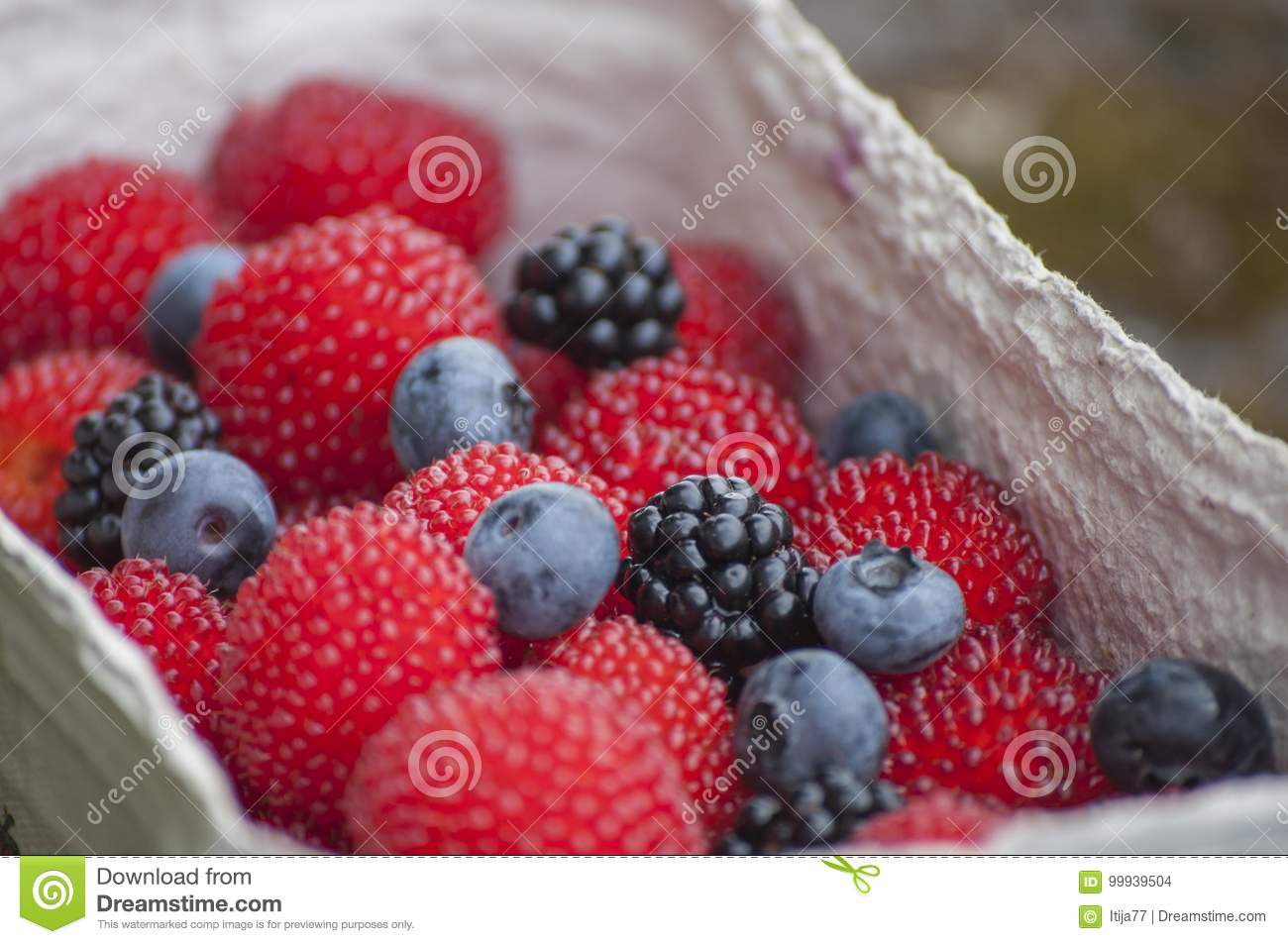 Closeup Of Red Balloon Berries Or Strawberry Raspberry Blueberries And Blackberries