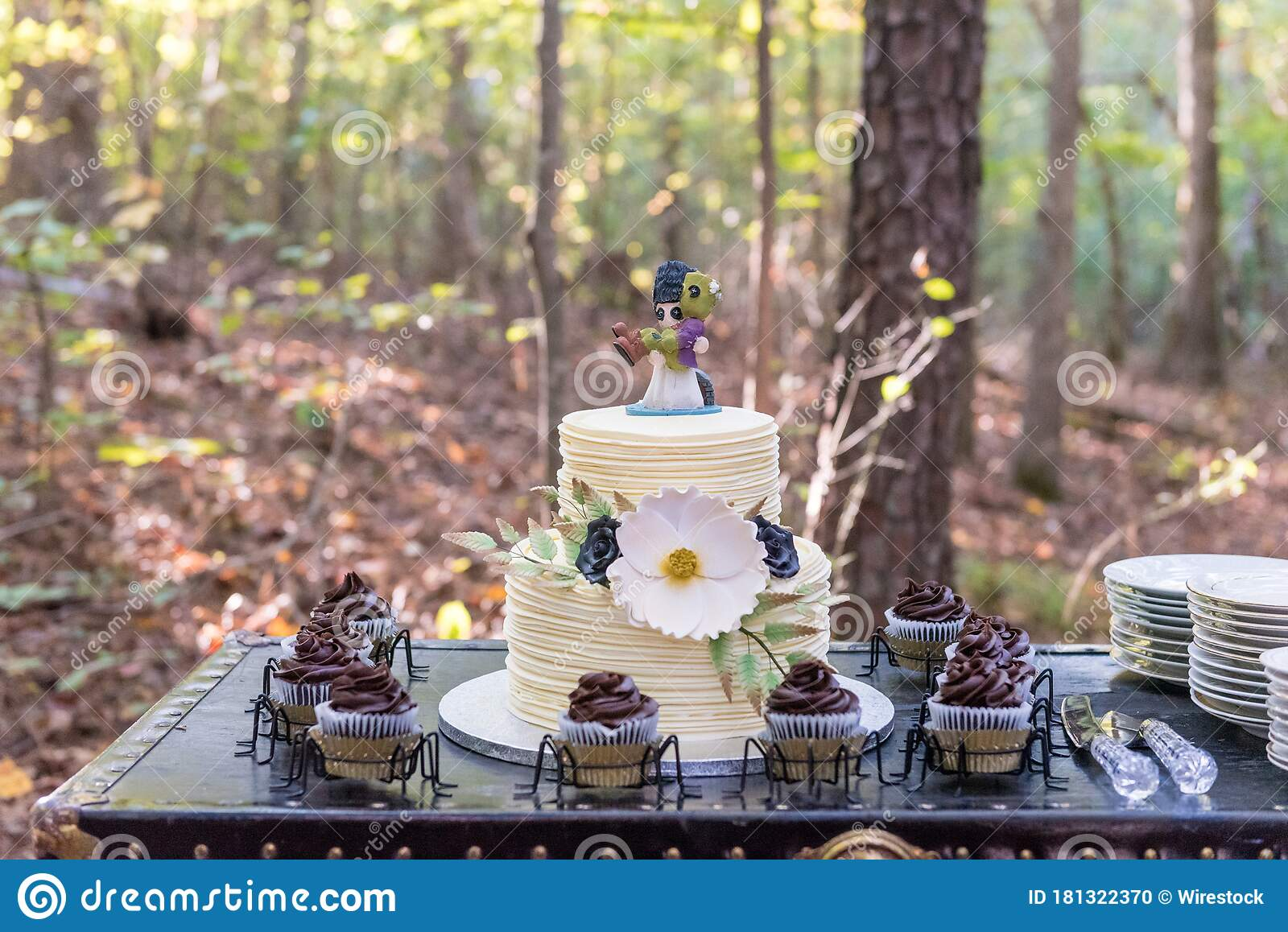 Closeup Selective Focus Shot Of A Wedding Cake With Chocolate Cupcakes With A Forest On The Back Stock Photo Image Of Setting Restaurant 181322370