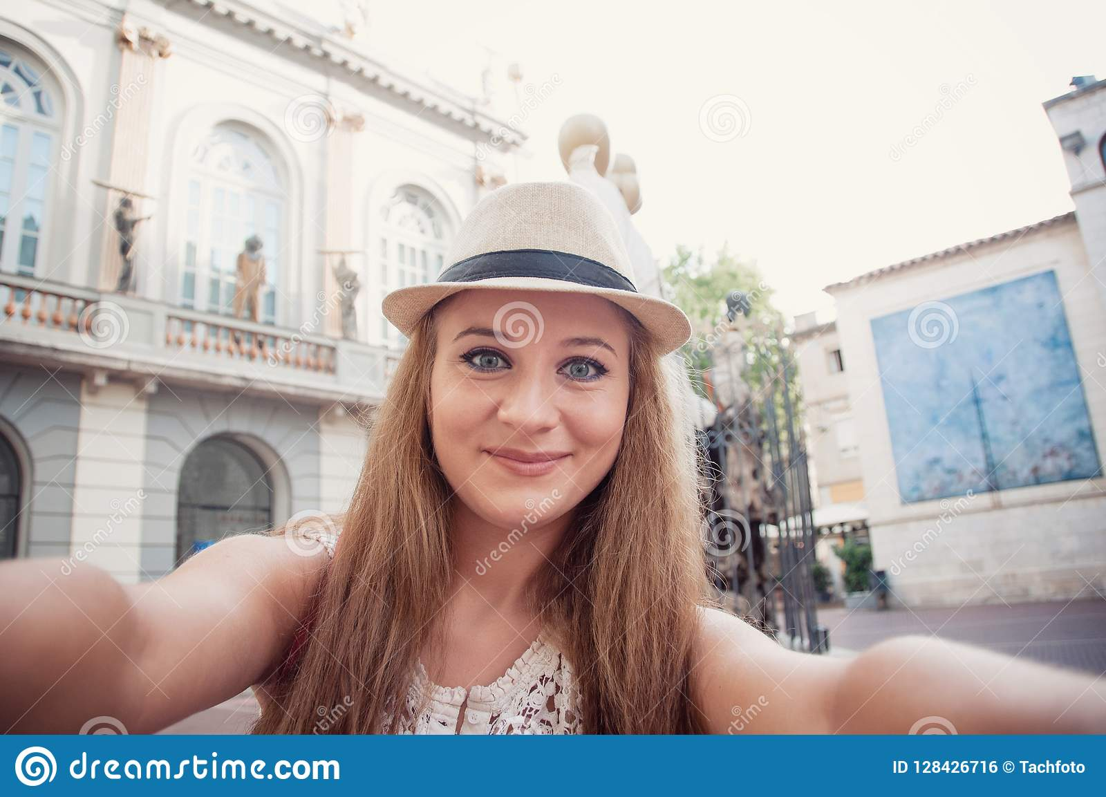 Closeup selfie-portrait of funny attractive girl tourist smiling