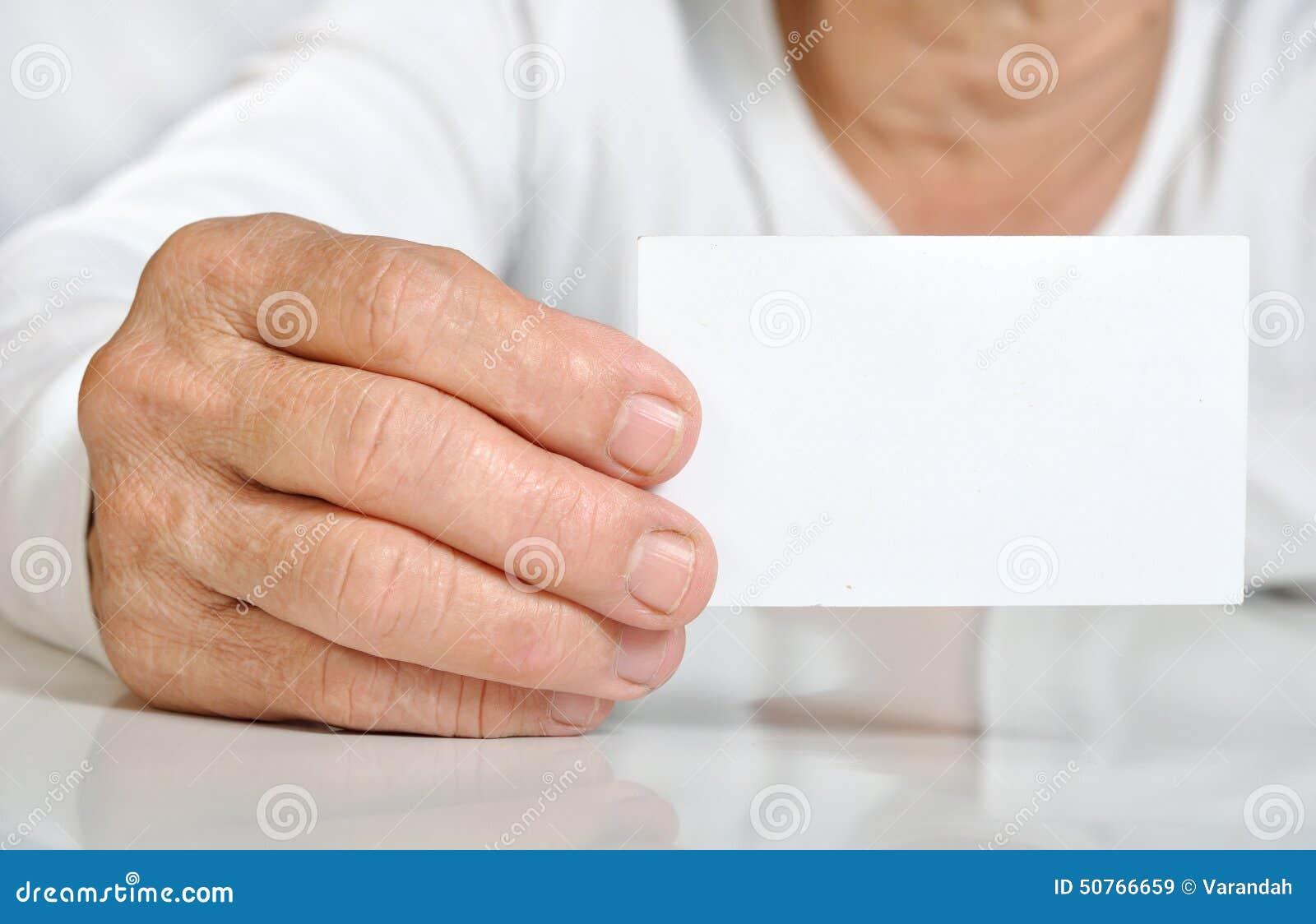 Closeup senior woman hand hold the blank card