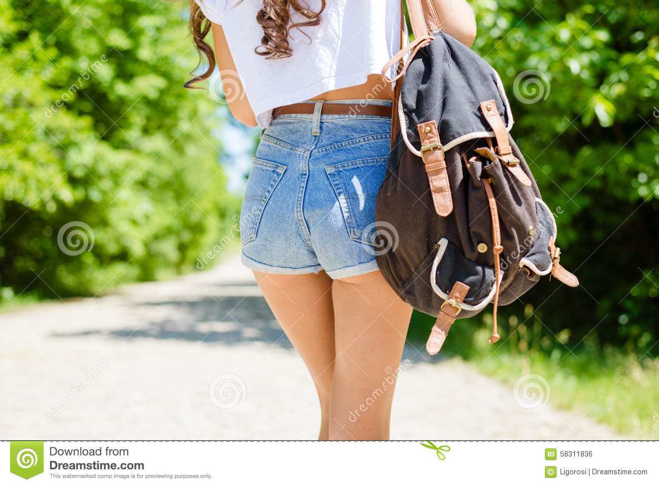 closeup on sexi female butts in jeans shorts with stock photo