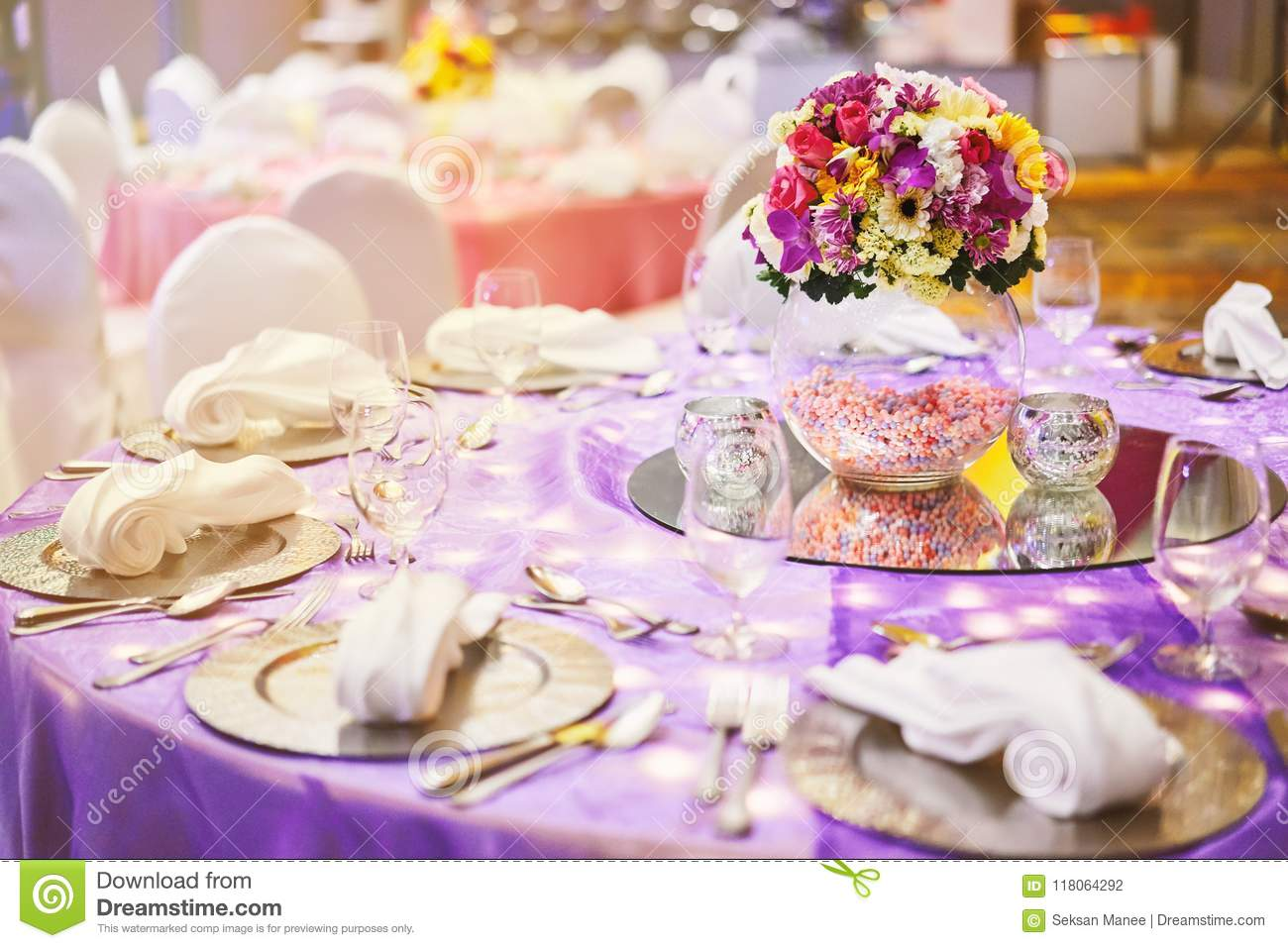 Dinner Table Setting With A Glass Vase Of Flower Bouquet Decoration ...