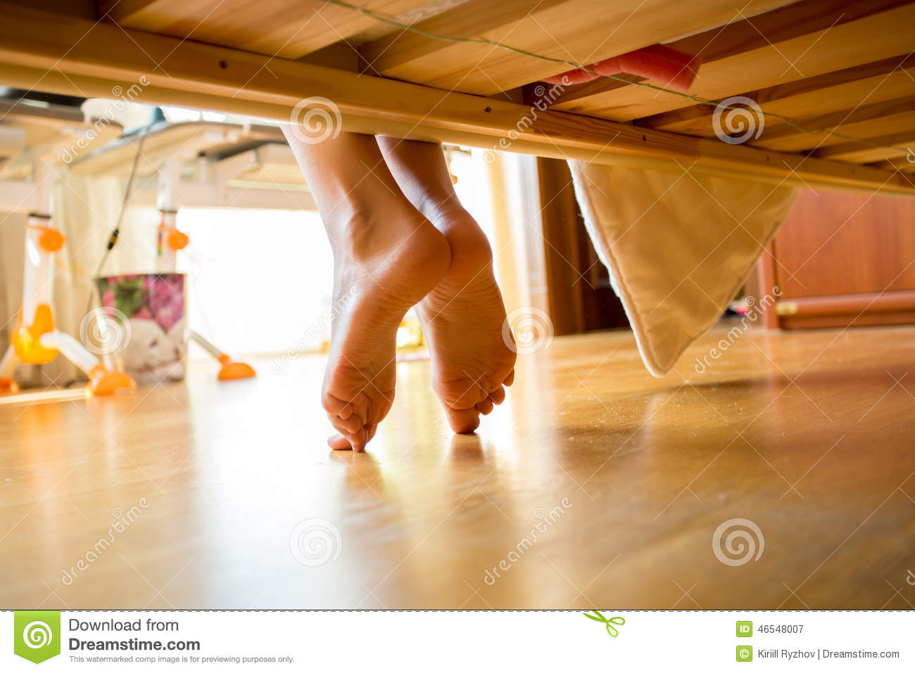 Closeup shot of female feet under bed stock image image for Warm toes radiant heat