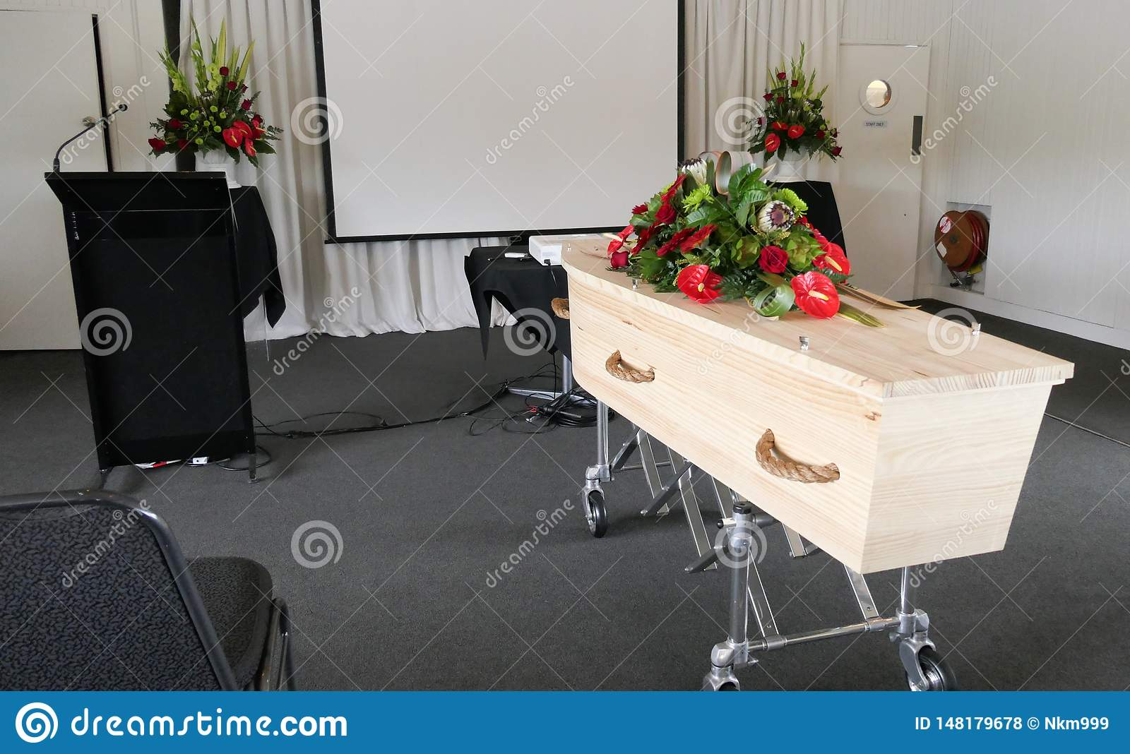 Funeral casket in a hearse or chapel or burial at cemetery