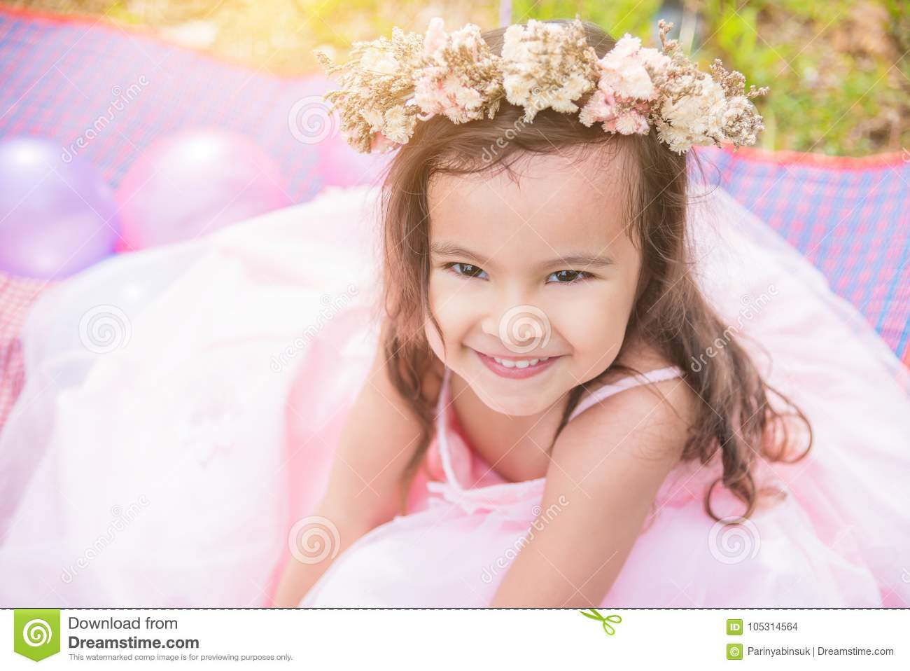 5f42c63877 Little Girl Wearing Crown Flower Smiling In Park Stock Photo - Image ...