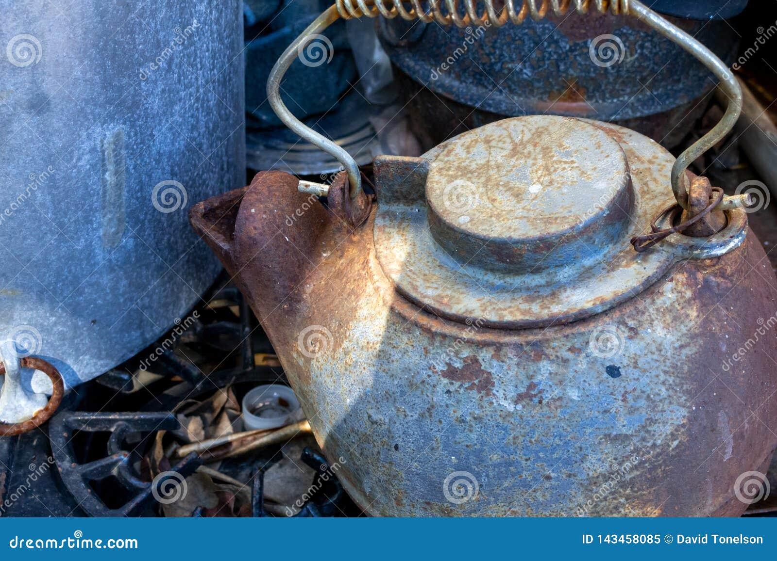 A vintage iron tea kettle