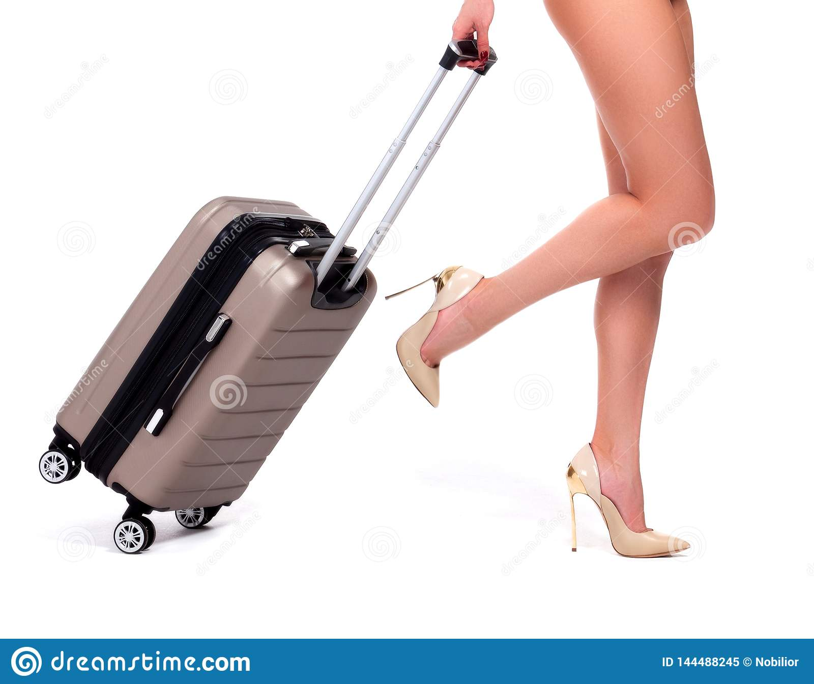 Closeup shot of woman who is pulling a suitcase