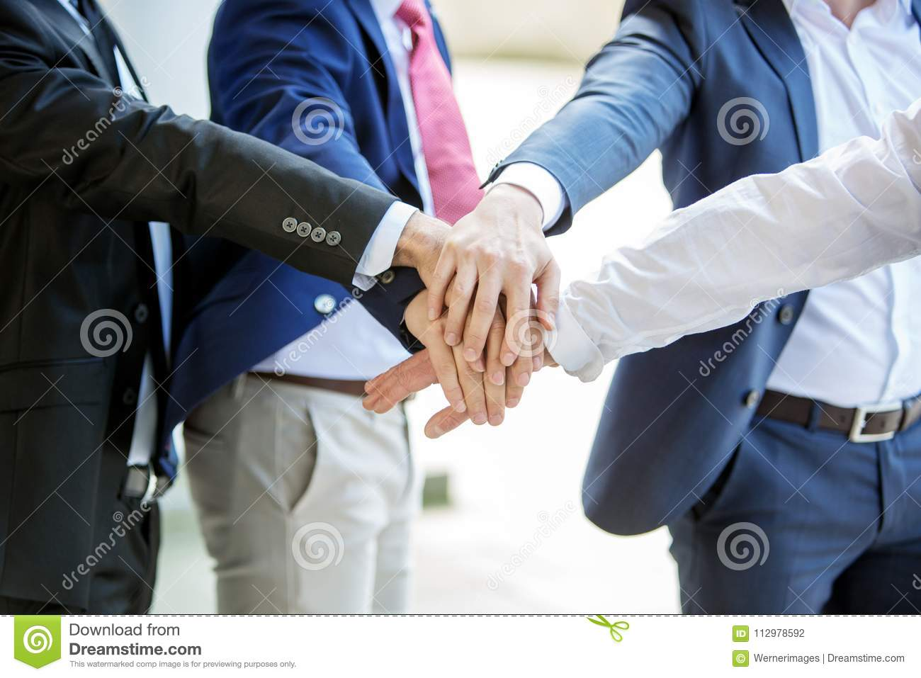 Closeup of six hands from businessmen together