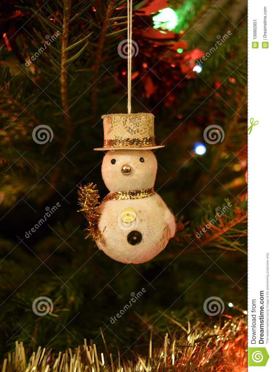 Closeup Of A Snowman Christmas Tree Decoration Hanging On A ...