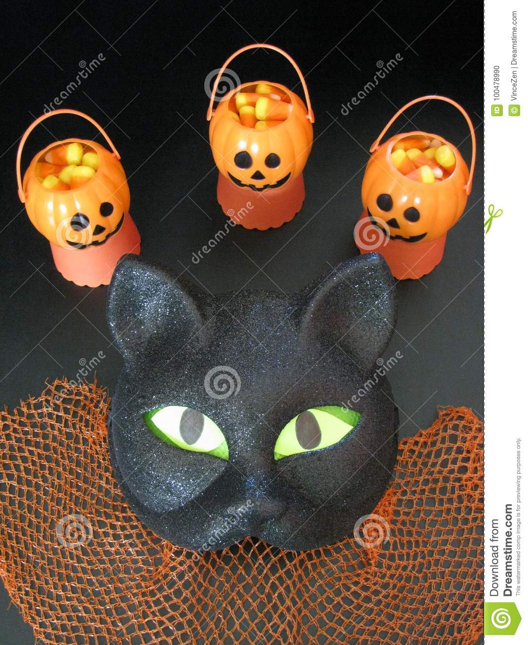 Closeup Of Sparkly Black Cat Halloween Mask And Mini Pumpkin Party
