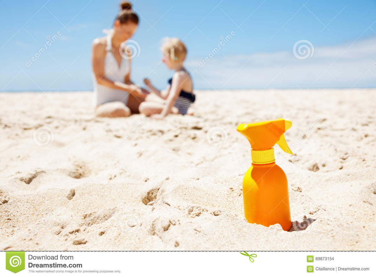 Closeup On Sunscreen Bottle Beach Family In Background
