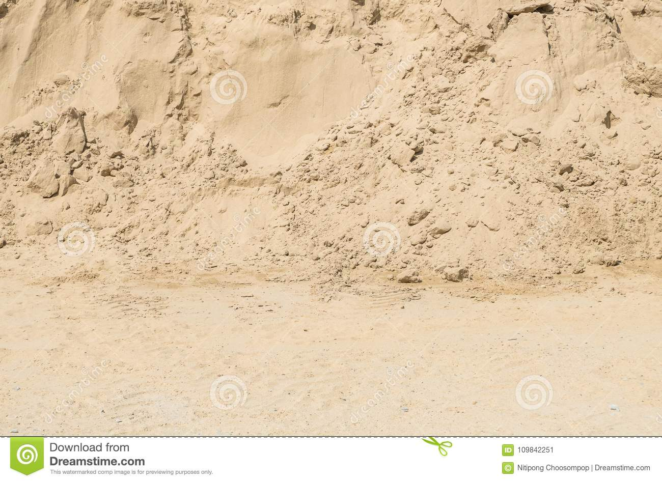 Closeup surface pile of sand for construction work with ground textured background