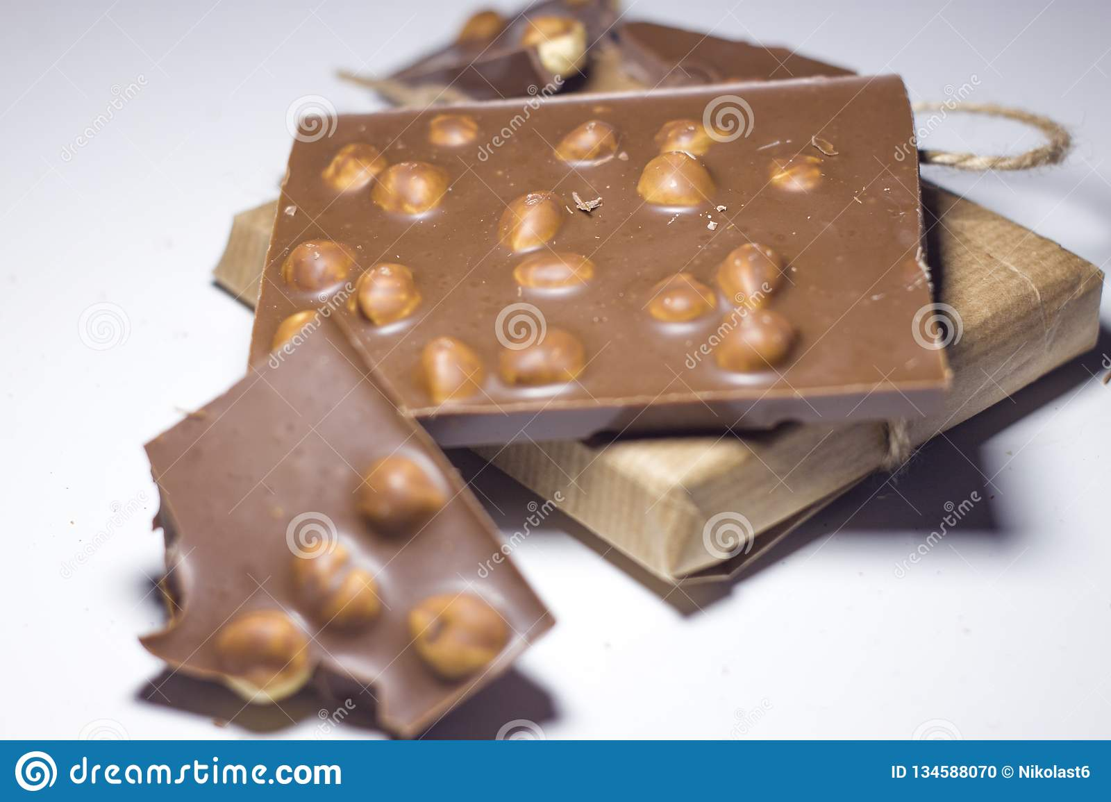Closeup of sweets, chocolate with nuts on a white background.
