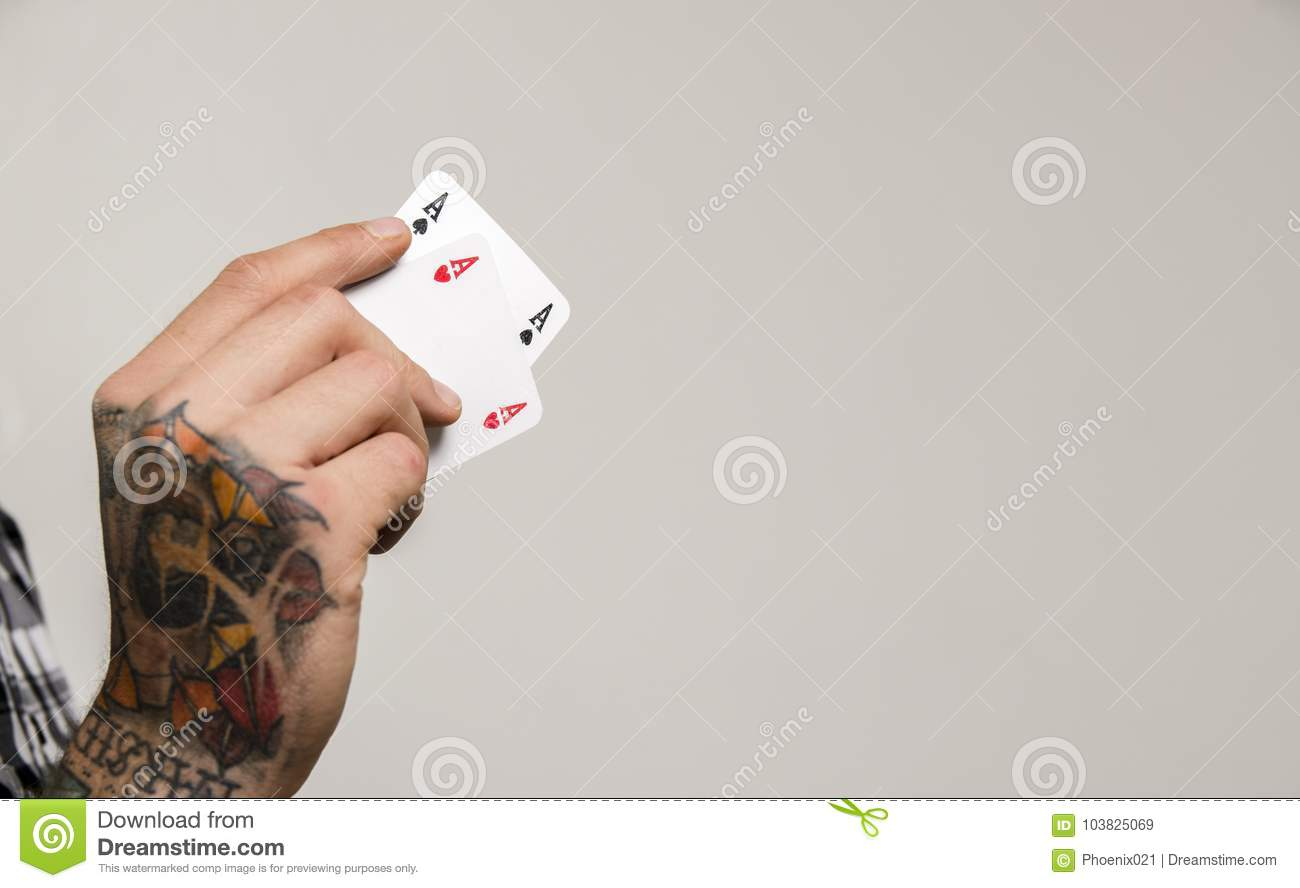 3cd8dab77 Closeup Of Tattooed Hand Holding Two Aces Stock Image - Image of ...