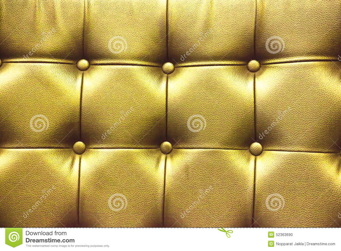 Closeup Texture Of Vintage Gold Leather Sofa For