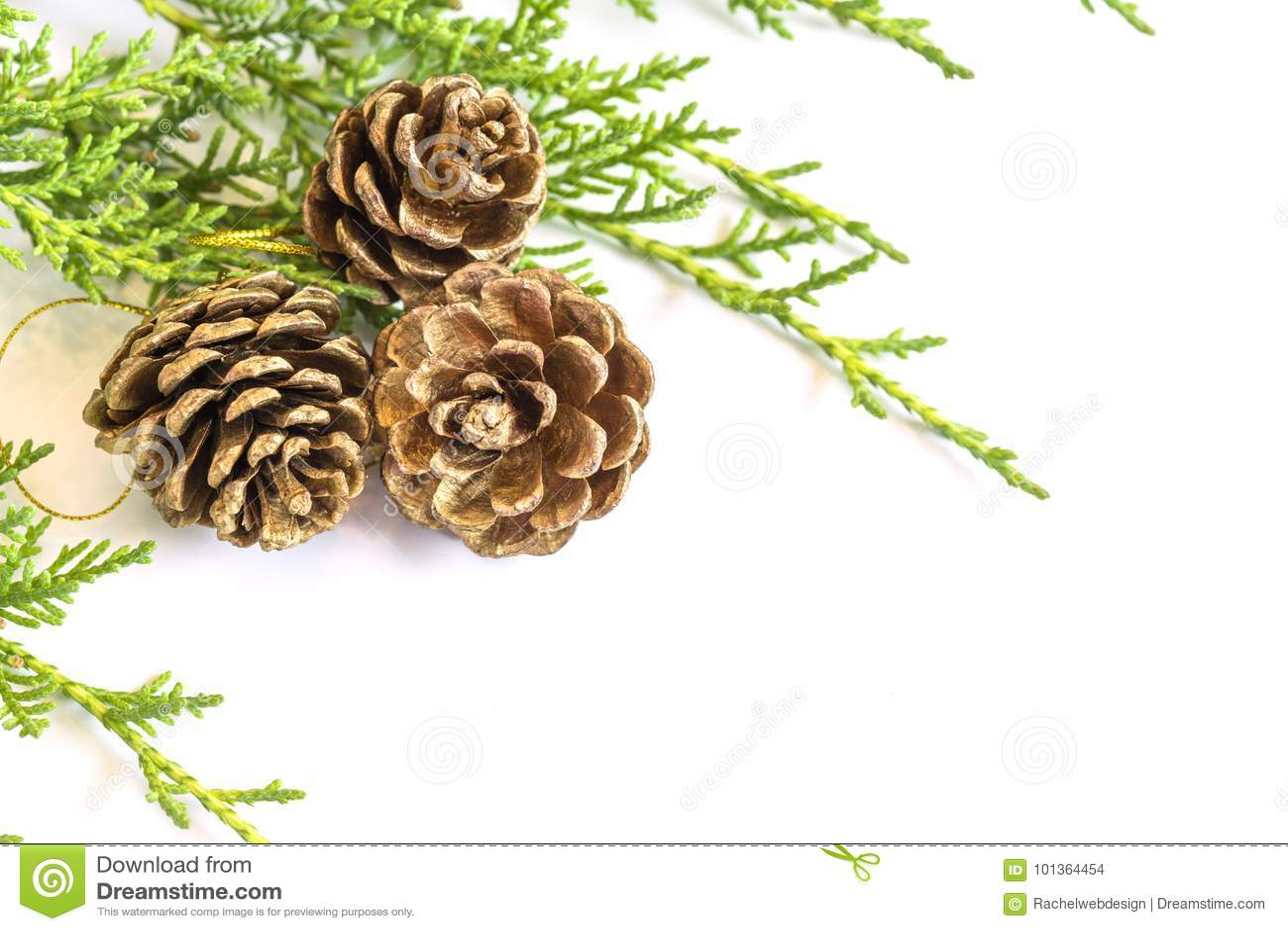 closeup of three golden pine cone decorations and pine tree bran