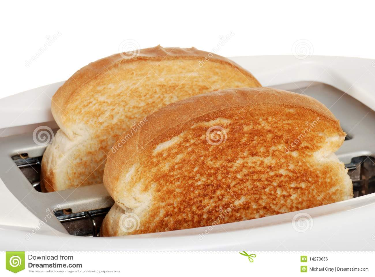 Toast In Toaster ~ Closeup toast in toaster royalty free stock image