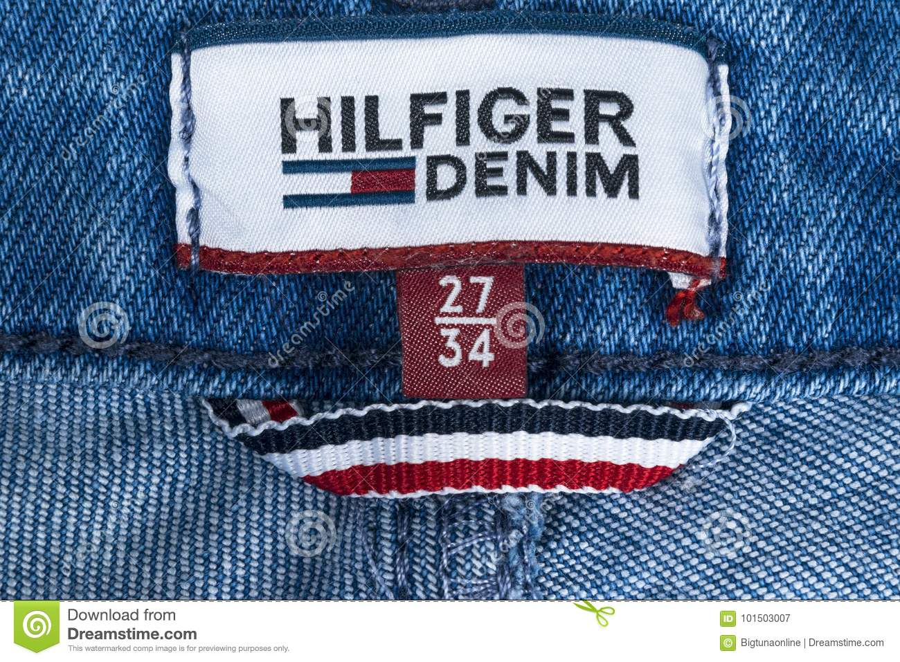 52990aa5 Closeup of Tommy Hilfiger label on blue jeans. Tommy Hilfiger is lifestyle  brand. Hilfiger
