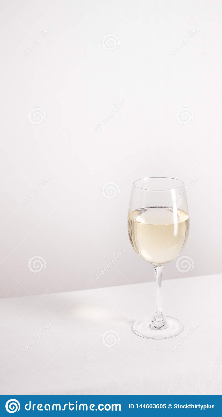 Closeup of transparent clear crystal glass of white wine