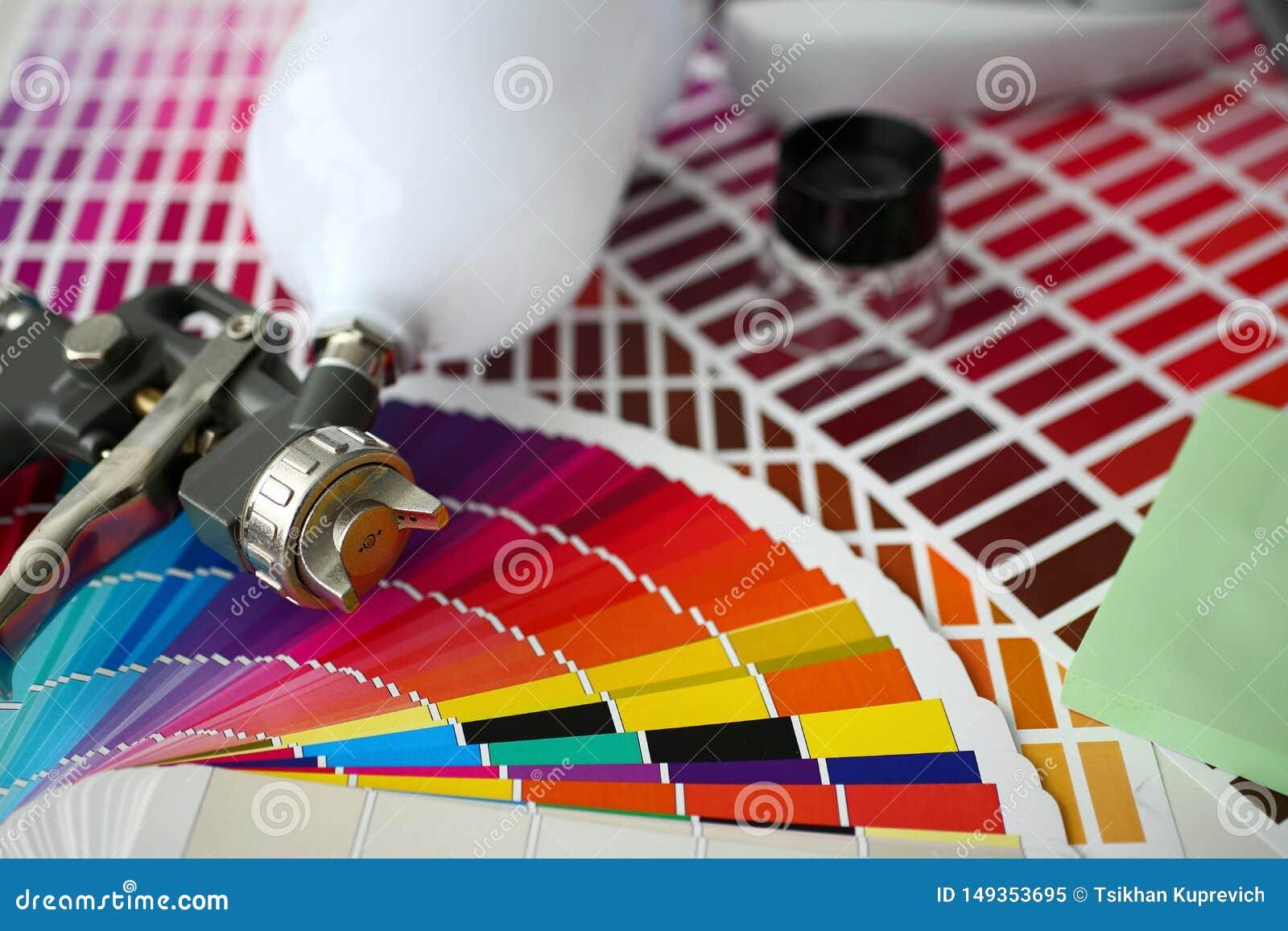 Closeup View Of Airbrush Gun Lying At Colour Check Stock