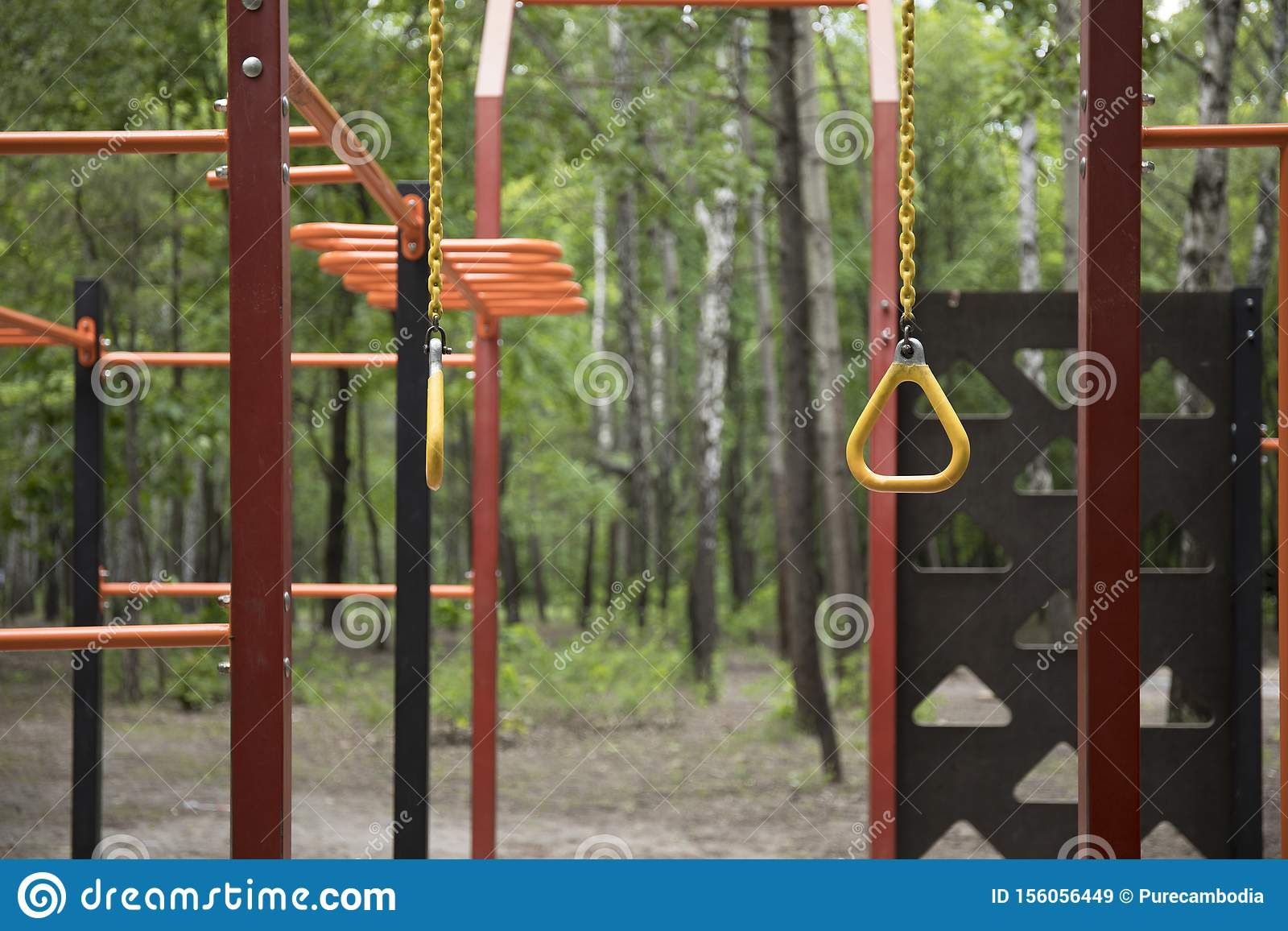 Closeup view of a monkey bar street sport gym metal construction for pulling and climbing on the sports field