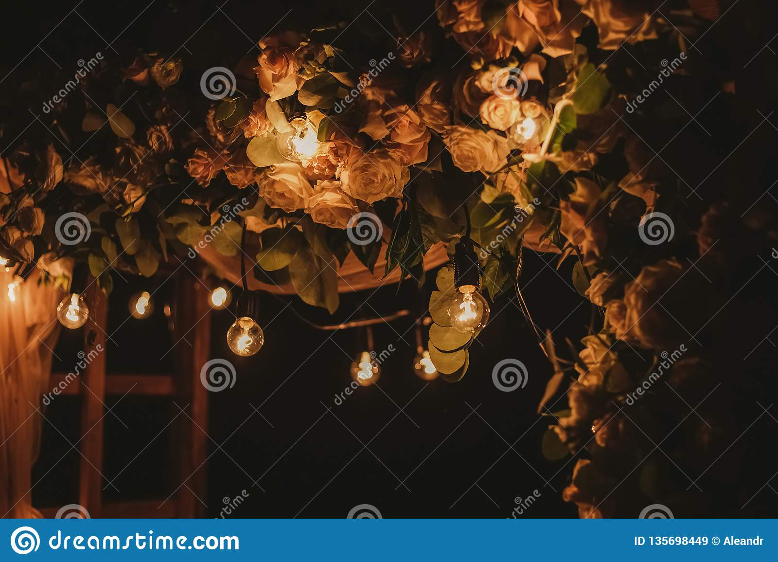 Closeup view of top of beautiful floral night wedding decorations
