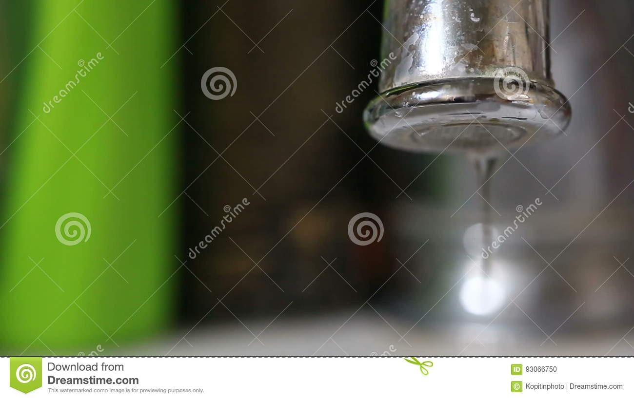 Closeup Of Water Dripping From A Kitchen Tap - Water Wasting Concept ...