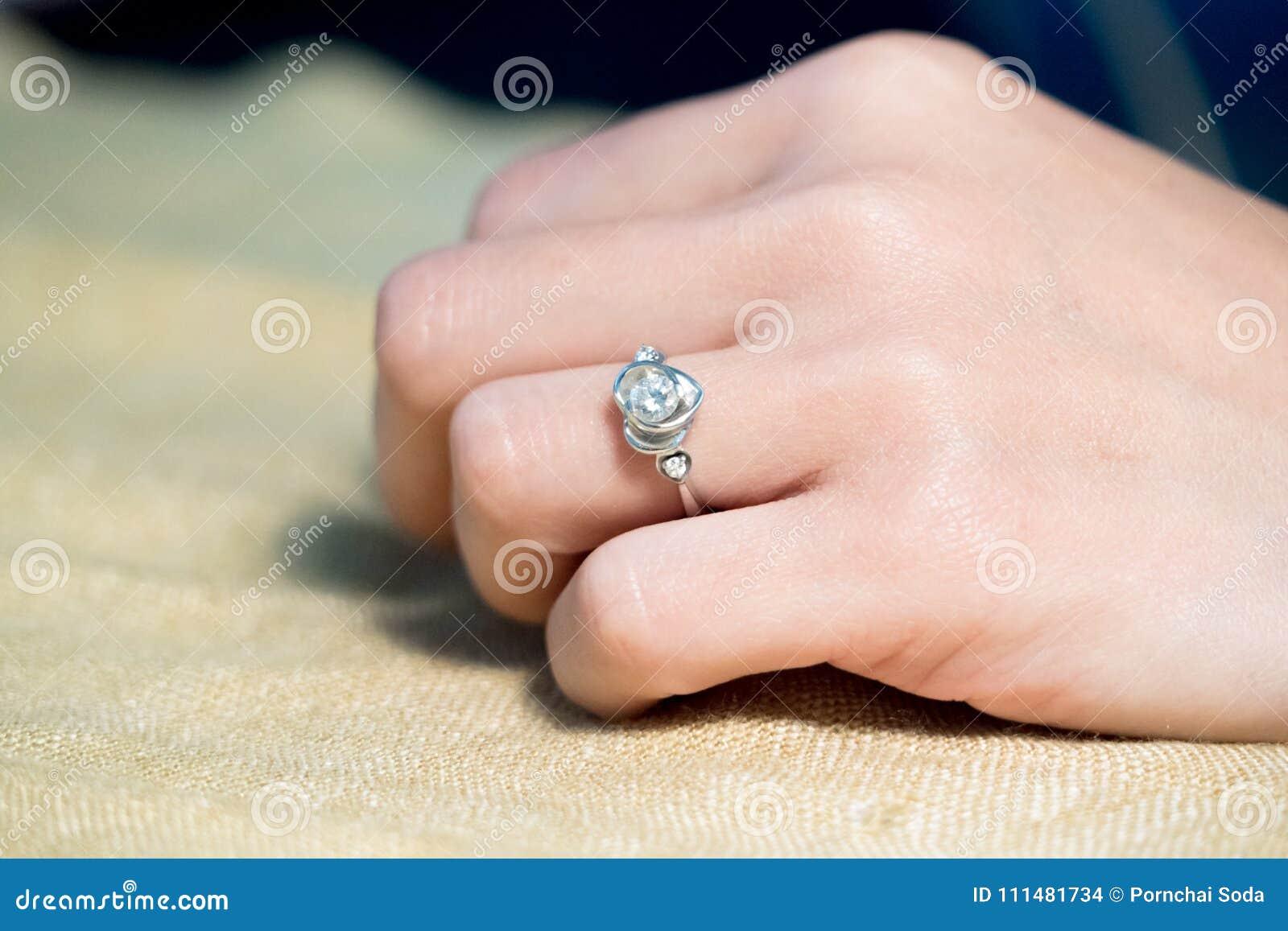 Closeup The Wedding Beautiful Diamond Ring On Women Ring Finger ...