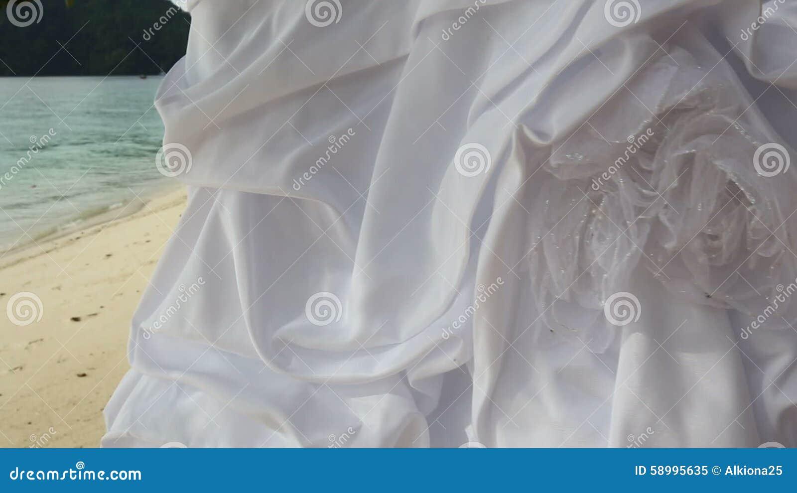 Closeup Of White Wedding Dress Hangs On Green Tree Stock Video Bridal Model 58995635: Tropical Island Beach Wedding Dresses At Reisefeber.org