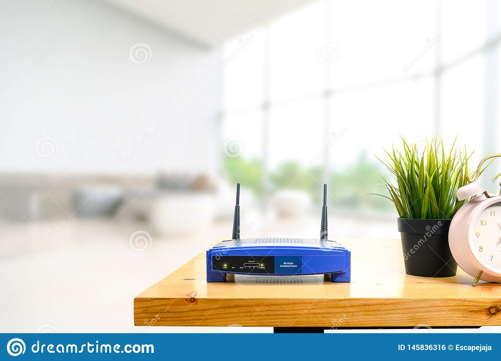 Closeup of a wireless router on living room at home with a window in the background