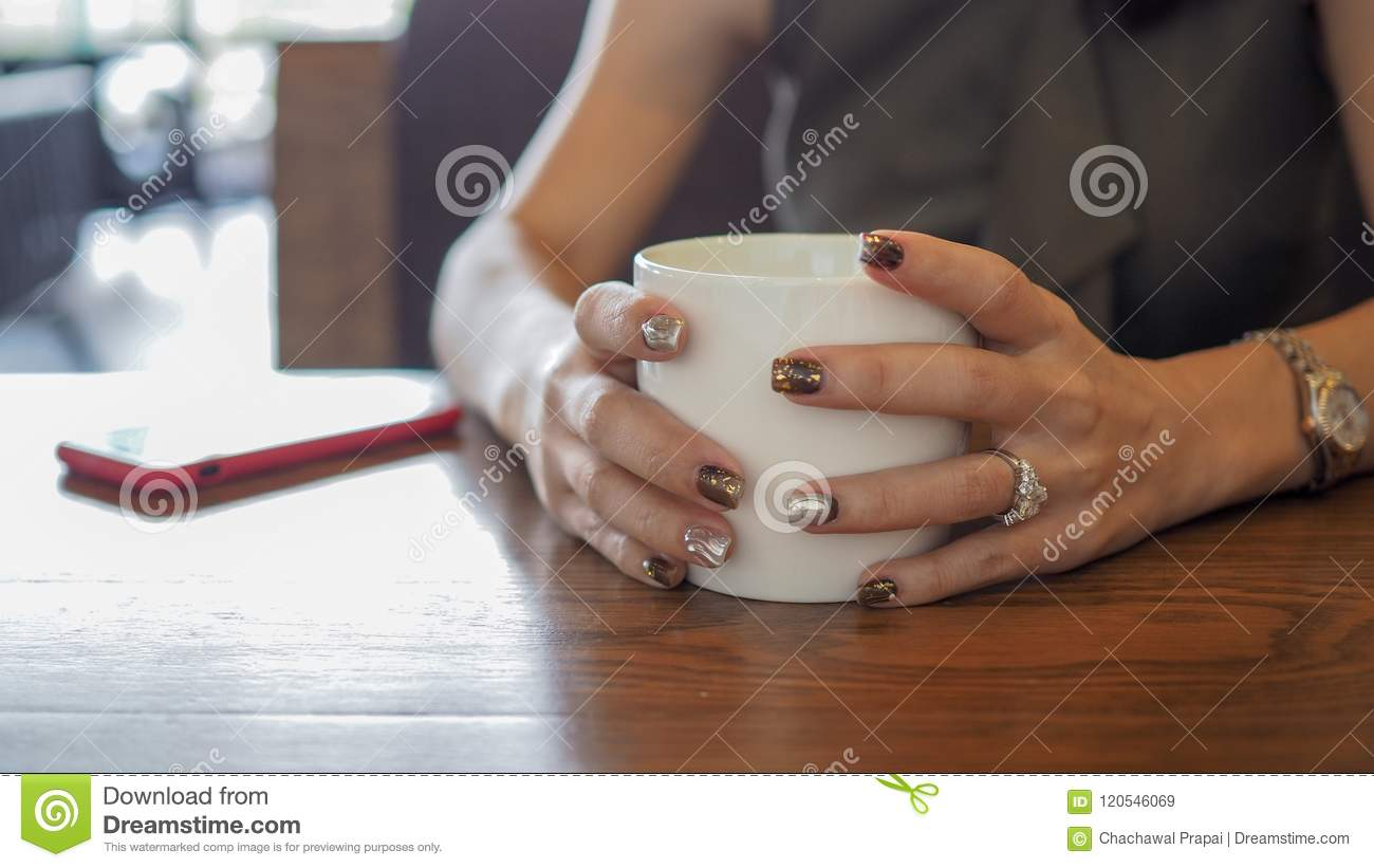 Closeup of beautiful woman's hands.