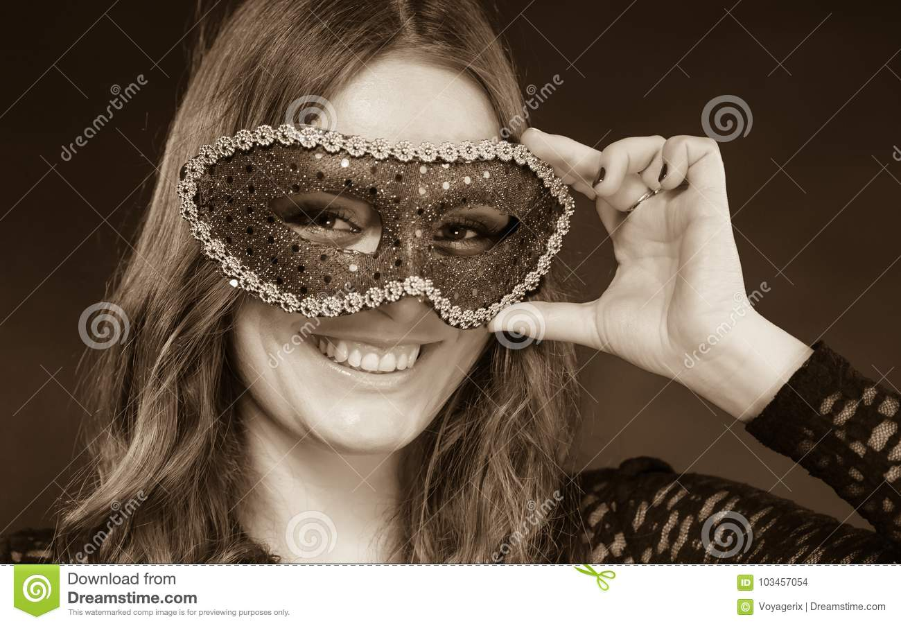 4c936b8dc5852 Holidays, people and celebration concept. Closeup woman face with carnival  venetian mask on dark background, black and white photo