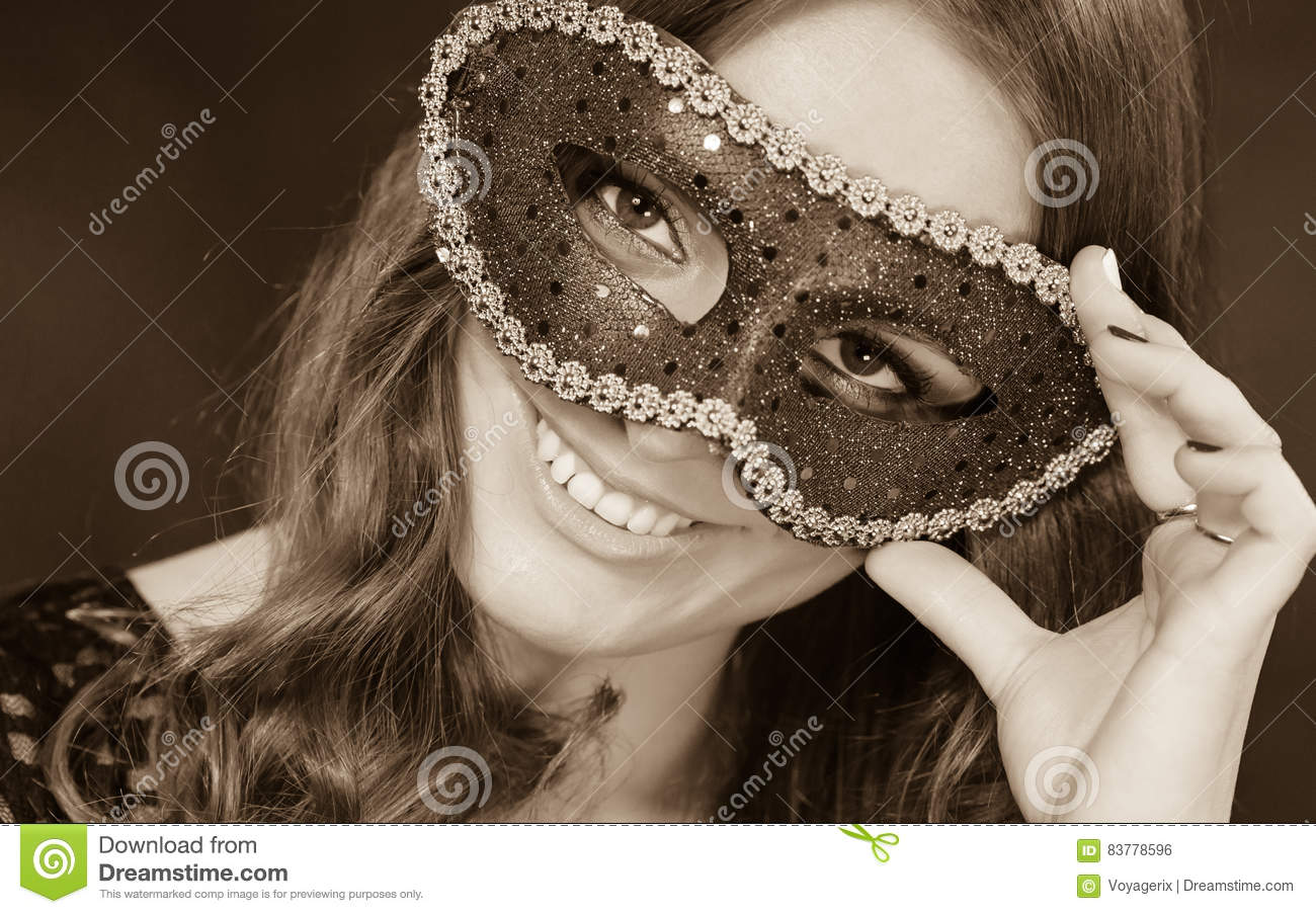 199049f7eb7b Holidays, people and celebration concept. Closeup woman face with carnival  venetian mask on dark background, black and white photo