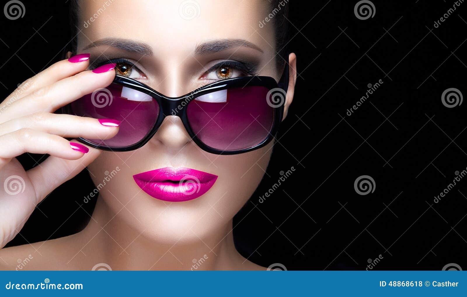Closeup Woman Face In Pink Oversized Sunglasses. Makeup