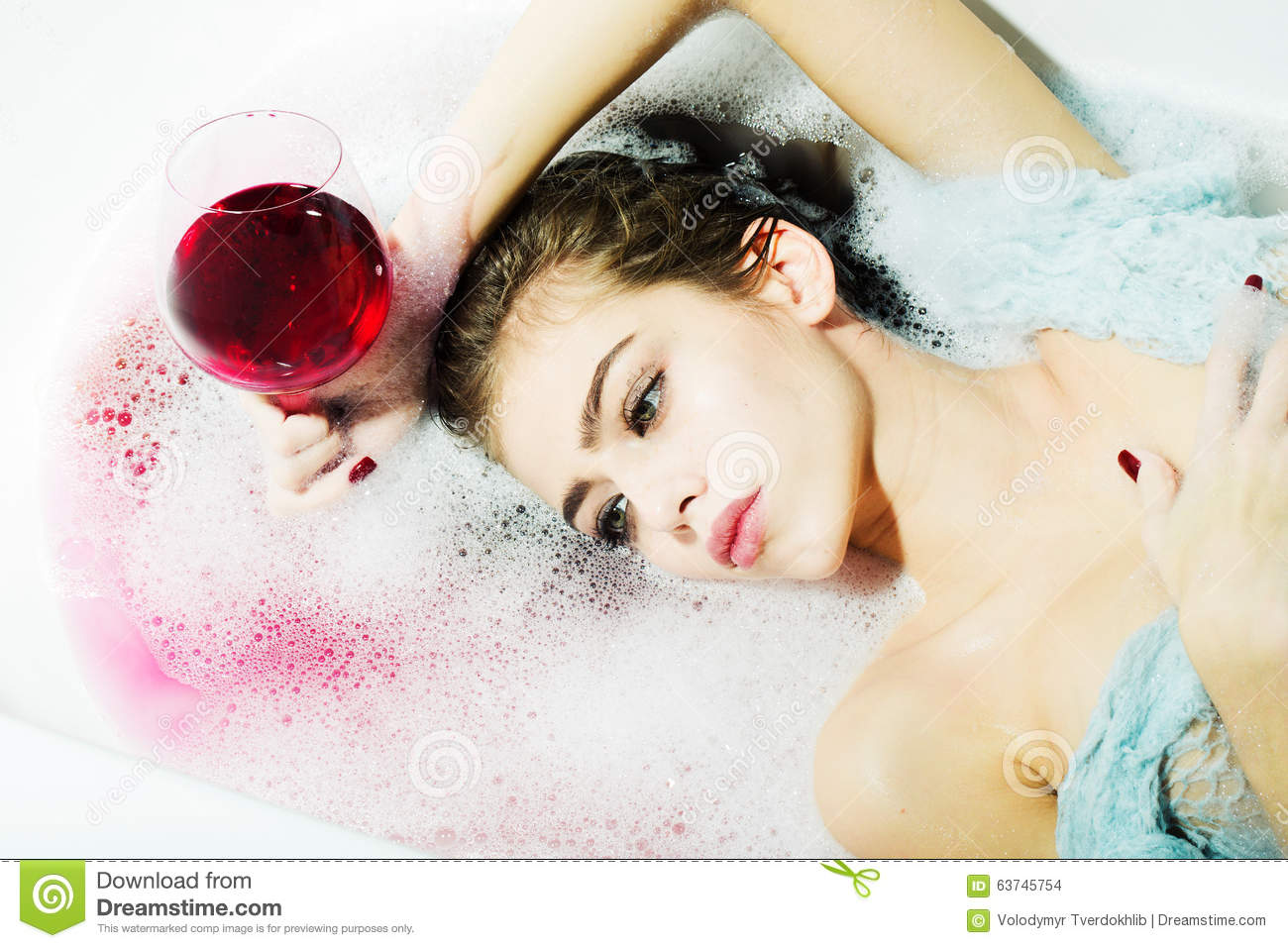 Closeup of woman with glass in bath stock photo image for Hot bathrooms photos