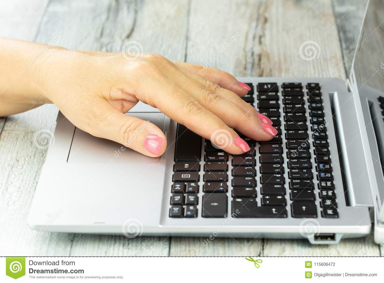 9df44e692 Closeup woman hand working on keyboard of notebook at rustic bright table.  Concept business woman