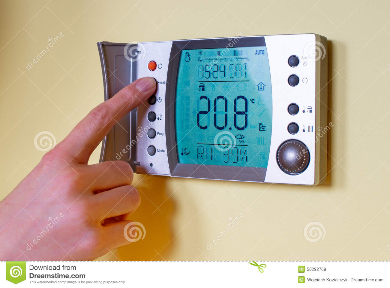 Closeup Of A Womans Hand Setting The Room Temperature On A