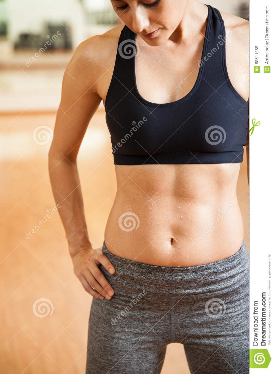 Teens with abs in sports bras curiously